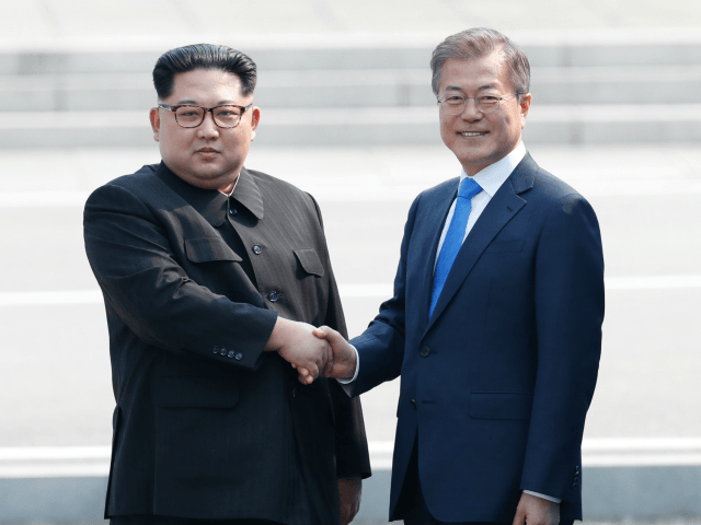 North Korean leader Kim Jong Un (L) and South Korean President Moon Jae-in (R) shake hands after Kim crossing the military demarcation line upon meeting for the Inter-Korean Summit April 27, 2018 in Panmunjom, South Korea. (Photo by Korea Summit Press Pool/Getty Images)