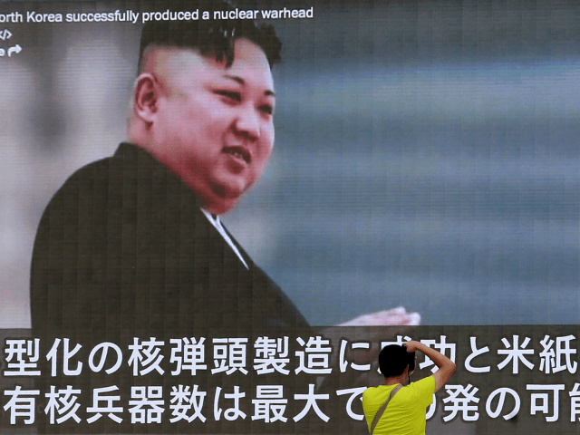 In this Aug. 6, 2017, file photo, a man takes a photo of a TV news program in Tokyo, showing an image of North Korean leader Kim Jong Un. The U.S. intelligence agencies' assessments of the size of North Korea's nuclear arsenal have a wide gap between high and low …
