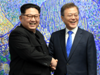 North Korean leader Kim Jong Un (L) and South Korean President Moon Jae-in (R) pose for photos in front of Bukhansan Peace House for the Inter-Korean Summit on April 27, 2018 in Panmunjom, South Korea. Kim and Moon meet at the border today for the third-ever Inter-Korean summit talks after …