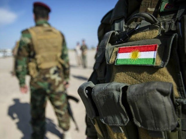 Bashiqa, Iraq - April 20: National flag of Kurdistan on a uniform of a Kurdish soldier on April 20, 2017 in Bashiqa, Iraq. (Photo by Florian Gaertner/Photothek via Getty Images)