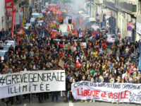 "Demonstrators march during a protest against French President Emmanuel Macron's government reforms, in Marseille, France, Saturday, April 14, 2018. Banners read: ""Indefinite general strike-Against the laws which oppress us, freedom and asylum"". (AP Photo/Claude Paris)"