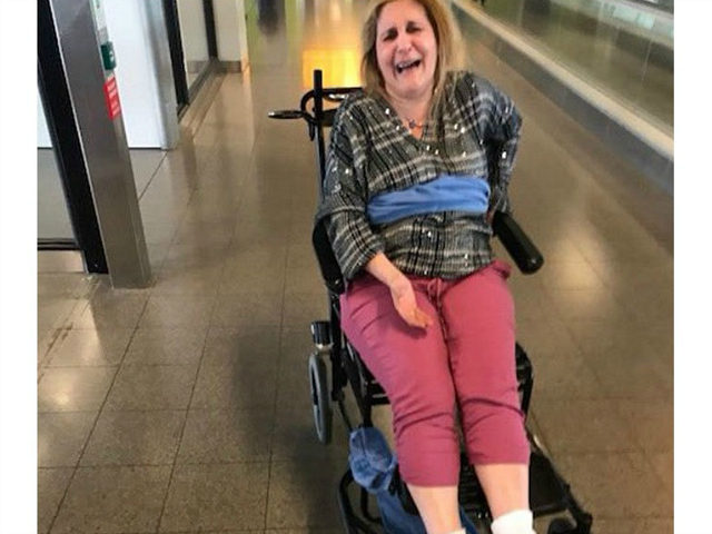 Woman says Delta workers tied her to wheelchair with blanket on flight