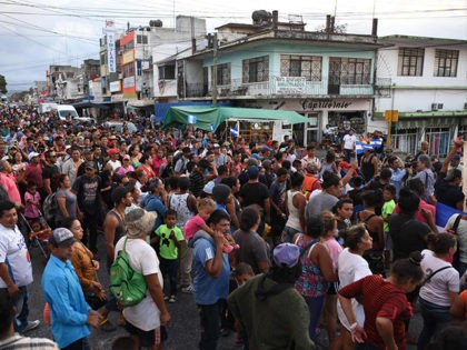 Central American migrants taking part in a caravan called 'Migrant Viacrucis' towards the United States march to protest against US President Donald Trump's policies as they remain stranded in Matias Romero, Oaxaca State, Mexico, on April 3, 2018. The hundreds of Central Americans in the 'Way of the Cross' migrant …