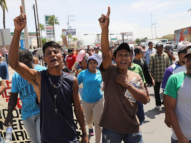 HERMOSILLO, MEXICO - APRIL 23: Central American immigrants, part of an immigrant 'caravan,' march in protest against U.S. President Donald Trump on April 23, 2018 in Hermosillo, Mexico. They demonstrated against Trump's morning tweets calling for U.S. Homeland Security to stop them from crossing the border into the United States …