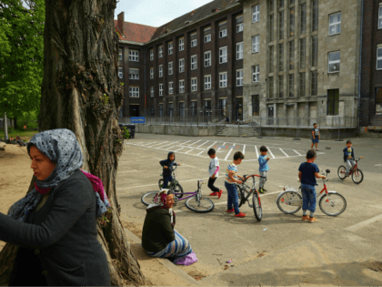 BERLIN, GERMANY - MAY 03: Residents of a shelter for refugees and migrants in Marienfelde district relax in the courtyard of the shelter, which was previously an administrative building for a supermarket chain, on May 3, 2017 in Berlin, Germany. The shelter currently houses approximately 450 people, the majority of …