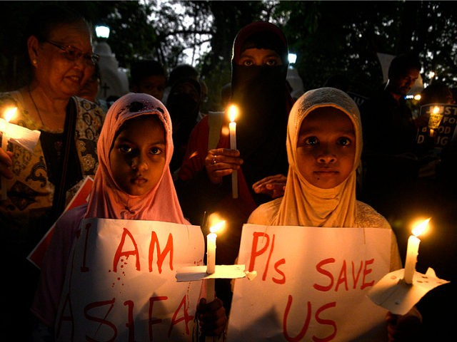 KOLKATA, WEST BENGAL, INDIA - 2018/04/17: Muslim girl holds the candle and poster along with other and takes part in the march against rape. People of different community participate in a candle light march against growing numbers of rape. (Photo by Saikat Paul/Pacific Press/LightRocket via Getty Images)