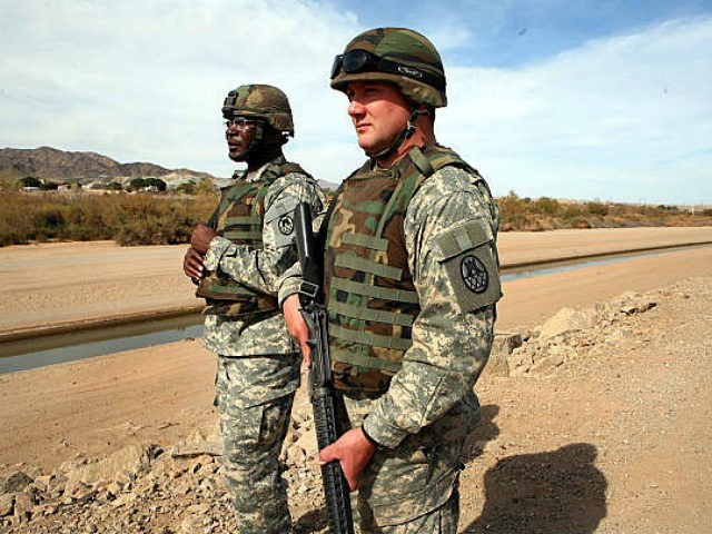 YUMA, ARIZONA - FEBRUARY 8: NC National Guardsmen watch the border in Yuma, Arizona, on February 8, 2007. The National Guard assists with surveillance and calls the Border Patrol if an illegal is spotted. The National Guard's Operation Jump Start has reduced illegal crossings by 75% compared to a year …