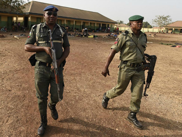 Policemen patrol at the internally displaced people camp occupied largely by women and children affected by herders and farmer's violent clashes from Logo and Guma communities at Gbajimba IDPs camp on the outskirts of Makurdi, capital of Benue State in northcentral Nigeria on January 3, 2018. Nomadic cattle herders have …