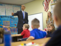 President Barack Obama takes questions from first grade students during a classroom visit at Gen. Clarence Tinker elementary school at MacDill Air Force Base, Fla., Wednesday, Sept. 17, 2014. Obama is returning to Washington after visiting US Central Command (CentCom) and was updated on the ongoing military campaigns in Iraq and Syria. Standing at the front with Obama is teacher Elizabeth Slagal. (AP Photo/Pablo Martinez Monsivais)