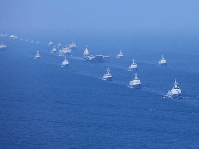 In this April 12, 2018 photo released by Xinhua News Agency, the Liaoning aircraft carrier is accompanied by navy frigates and submarines conducting an exercises in the South China Sea. China has announced live-fire military exercises in the Taiwan Strait amid heightened tensions over increased American support for Taiwan. The …