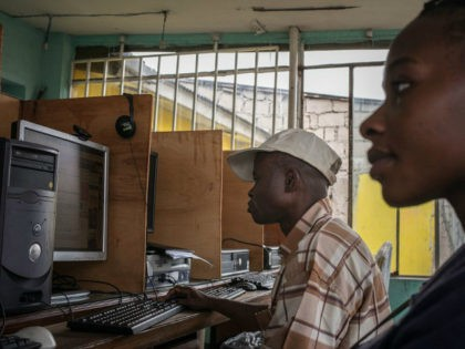 TO GO WITH AFP BY HABIBOU BANGRE Clients surf the internet at an internet cafe on February 25, 2015 in Kinshasa. Sales are down and business is slow -- small entrepreneurs in the Democratic Republic of Congo are bearing the brunt of an official clampdown on mobile Internet services and …
