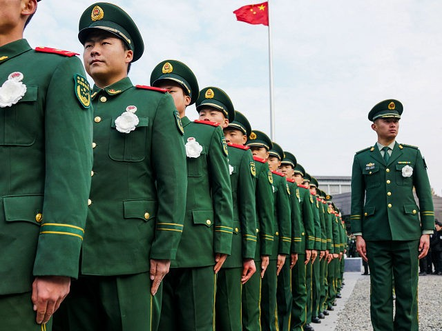 People's Liberation Army (PLA) soldiers participate in a ceremony at the Nanjing Massacre Memorial Hall on the second annual national day of remembrance to commemorate the 80th anniversary of the massacre in Nanjing on December 13, 2017. Sirens blared and thousands of doves were released as Chinese President Xi Jinping …