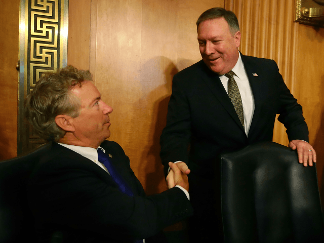 Secretary of State nominee Mike Pompeo (R), greets Sen. Rand Paul (R-KY), during his confirmation hearing before a Senate Foreign Relations Committee on Capitol Hill, on April 12, 2018 in Washington, DC. President Trump nominated Pompeo to replace Rex Tillerson as Secretary of State. (Photo by Mark Wilson/Getty Images)