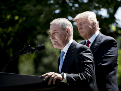 US President Donald Trump (L) listens to Environmental Protection Agency Administrator Scott Pruitt speak after announcing the US will withdraw from the Paris accord in the Rose Garden of the White House on June 1, 2017 in Washington, DC. 'As of today, the United States will cease all implementation of …