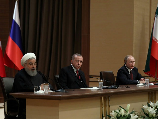 """Iran's President Hassan Rouhani, left, Russia's President Vladimir Putin, right, and Turkey's President Recep Tayyip Erdogan speak during a joint press conference in Ankara, Turkey, Wednesday, April 4, 2018. The leaders of Russia, Turkey and Iran say they stand against """"separatist"""" agendas that would undermine Syria's sovereignty and territorial integrity. …"""