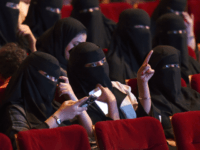 Saudi women attend the 'Short Film Competition 2' festival on October 20, 2017, at King Fahad Culture Center in Riyadh. The rare movie night this week in Riyadh was a precursor to what is expected to be a formal lifting of the kingdom's ban on cinemas, long vilified as vulgar and sinful by religious hardliners. / AFP PHOTO / FAYEZ NURELDINE (Photo credit should read FAYEZ NURELDINE/AFP/Getty Images)