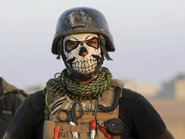 A member of Iraq's elite Special Forces wears a skull mask in the fight against the Islamic State in 2016. AP: Khalid Mohammed