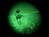 "U.S. Army flight crew chief Sgt. Robert Terrants is seen through night vision goggles as he stands in an opium field while waiting to medevac a lightly injured Marine in a helicopter of the U.S. Army's Task Force Lift ""Dust Off"", Charlie Company 1-214 Aviation Regiment north of Sangin, in the volatile Helmand Province of southern Afghanistan, Sunday, May 15, 2011. (AP Photo/Kevin Frayer)"