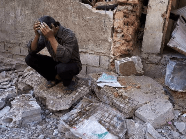A Syrian man mourns after an alleged chemical attack on the rebel-held town of Douma in Syria. At least 78 civilians, including women and children, died according to the initial findings. Photo by Mohammed Hassan/UPI