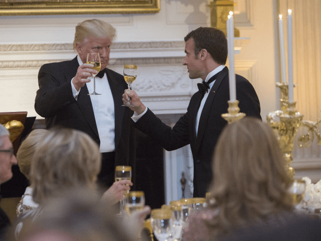 U.S. President Donald Trump shares a toast with French President Emmanuel Macron during the State Dinner for Macron and Mrs. Brigitte Macron of France during a visit to The White House, April 24, 2018 in Washington, DC. Trump is hosting Macron for a two-day official visit that included dinner at …