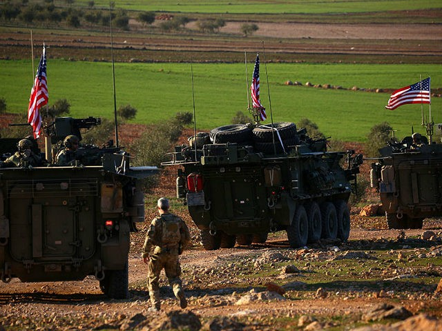 A convoy of US forces armoured vehicles drives near the village of Yalanli, on the western outskirts of the northern Syrian city of Manbij, on March 5, 2017. / AFP PHOTO / DELIL SOULEIMAN (Photo credit should read DELIL SOULEIMAN/AFP/Getty Images)