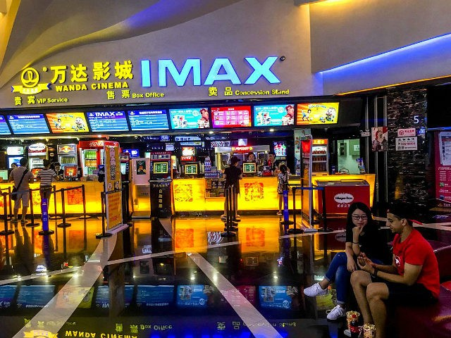 WEIFANG, SHANDONG PROVINCE, CHINA - 2016/08/30: Customers buy film ticket in a Wanda IMAX cinema. Wanda Cinema Line, Chinas biggest movie-theater operator, is expanding cooperation with U.S. company MediaMation and South Koreas CJ4D Plex to build over 100 new 4D cinemas in China. (Photo by Zhang Peng/LightRocket via Getty Images)