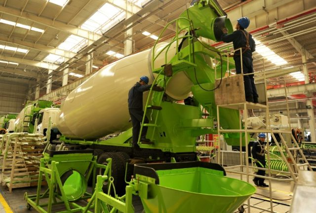 Employees work on a concrete mixing truck at a factory in Zhangjiakou in China's northern Hebei province