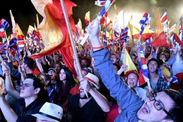 Supporters of Costa Rica's president-elect Carlos Alvarado celebrate in San Jose following his convincing victory