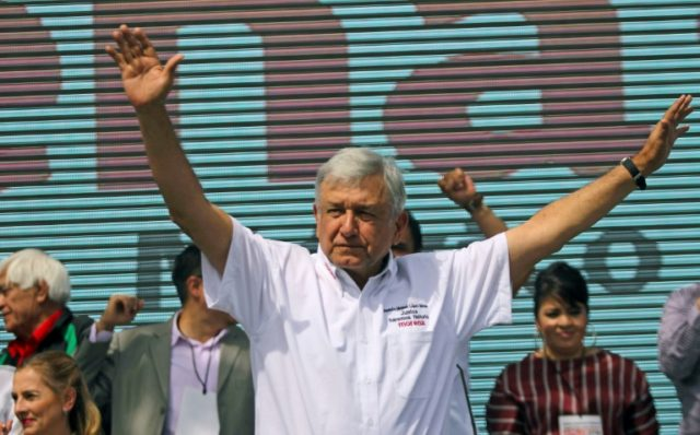 Mexico's presidential candidate Andres Manuel Lopez Obrador, standing for MORENA party, cheers at his supporters during his first campaign rally, in Ciudad Juarez