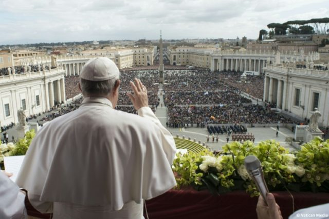 """Pope Francis delivers the """"Urbi et Orbi"""" blessing to 80,000 pilgrims in St Peter's Square, as well as the millions watching the broadcast around the world"""