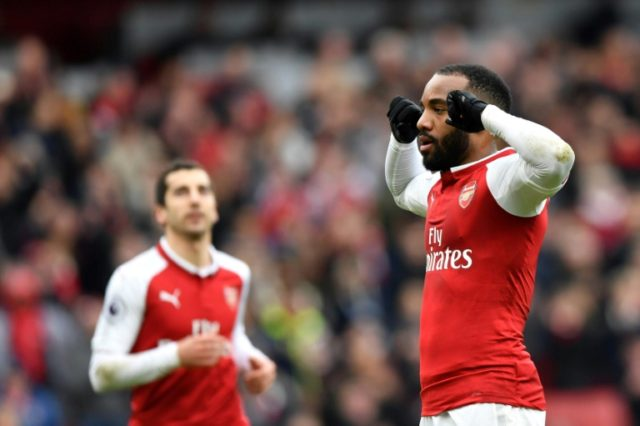 On target: Arsenal striker Alexandre Lacazette celebrates scoring