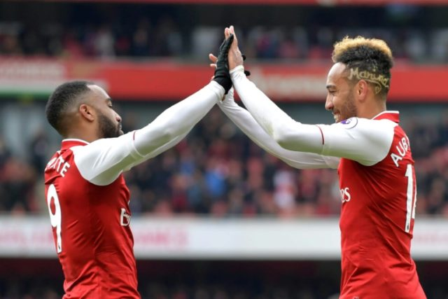 Alexandre Lacazette and Pierre-Emerick Aubameyang scored the goals as Arsenal continued their momentum with victory over struggling Stoke