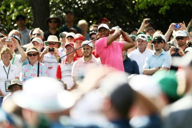 Tiger Woods of the United States plays a shot during a practice round prior to the start of the Masters Tournament on April 2, 2018 in Augusta, Georgia