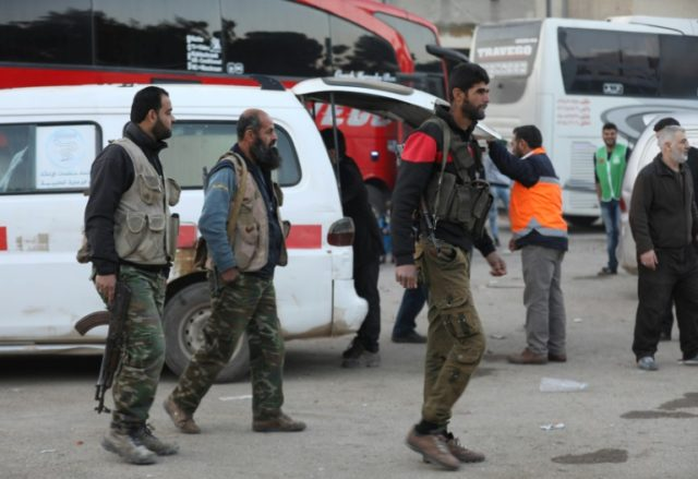 Syrian civilians and fighters arrive in Qalaat al-Madiq, some 45 kilometres northwest of the central city of Hama, on April 2, 2018 after being evacuated from the Eastern Ghouta town of Douma