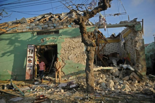 A building destroyed by a car bomb attack in a street in Mogadishu, Somalia, on March 22, 2018