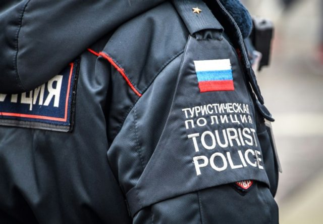 A tourist policewoman are on patrol in downtown Moscow, with two months to go to the World Cup, the Russian government is thinking creating units in other cities