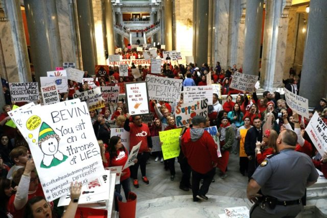 Public school teachers and their supporters protest against a pension reform bill outside the senate chambers at the Kentucky State Capital on April 2, 2018 in Frankfort, Kentucky