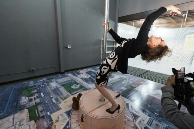 Nina Crowe takes a selfie at an exhibit mimicking the view from Los Angeles' tallest building