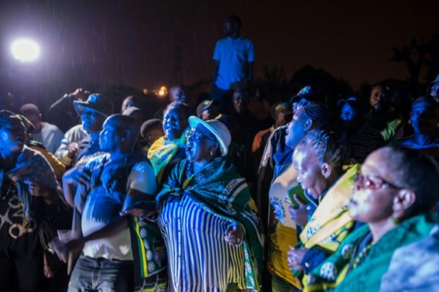 Neighbours gathered outside Winnie Mandela's home in her township community in Soweto to celebrate her legacy