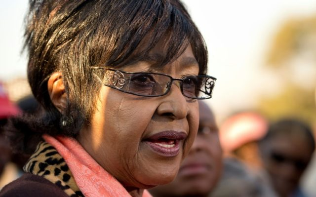 Winnie Mandela Madikizela, the former wife of Nelson Mandela, speaks to the media outside their first family home in Soweto on June 28, 2013