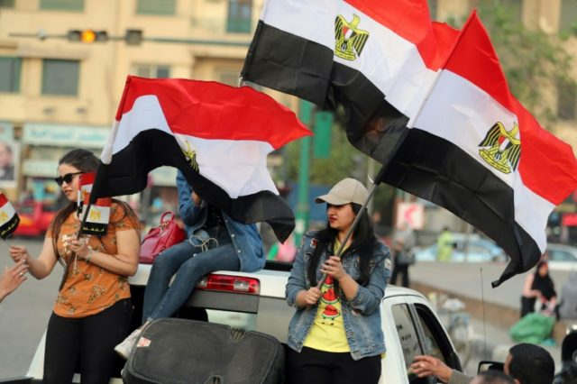Supporters of Egyptian President Abdel Fattah al-Sisi celebrate in Cairo's Tahrir square following his re-election for a second term with 97 percent of the vote