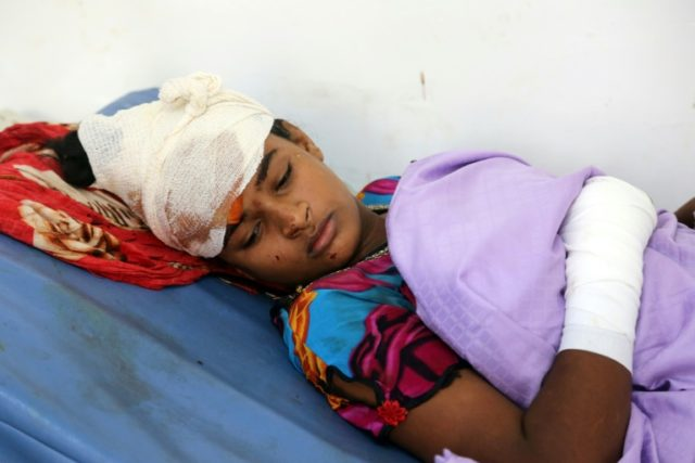 A Yemeni child who was injured in air strike in the district of Al-Hali in Hodeida province, receive treatment at a hospital on April 2, 2018
