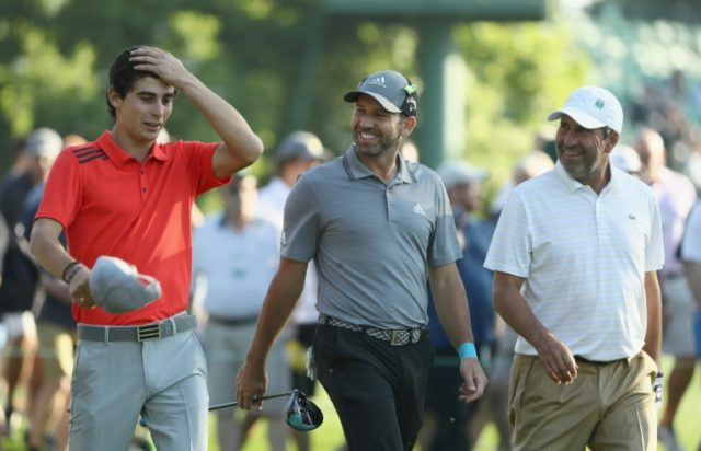 Amateur Joaquin Niemann of Chile speaks with Sergio Garcia and Jose Maria Olazabal of Spain during a practice round prior to the start of the 2018 Masters Tournament at Augusta National Golf Club on April 3, 2018