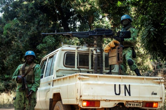 UN peacekeepers from Cameroon deployed to the Central African Republic stand guard during an inspection in the northwesten village of Bedaya in January 2018