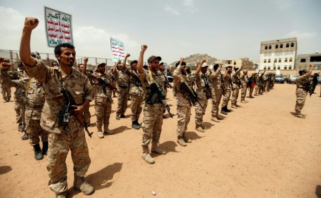 Newly recruited Huthi rebel fighters chant slogans in the Yemeni capital Sanaa on July 16, 2017
