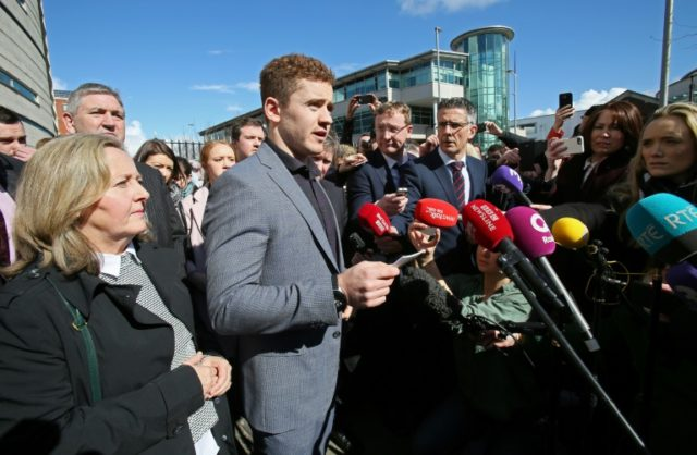 Irish rugby player Paddy Jackson speaks to members of the media as he leaves court in Belfast in March 2018, after being found not quilty of a charge of rape