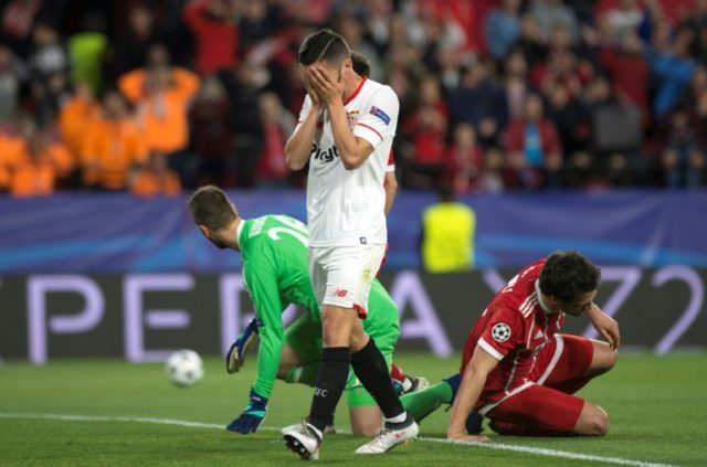Sevilla's Spanish midfielder Pablo Sarabia covers his face during the UEFA Champions League quarter-final first leg football match between Sevilla FC and Bayern Munich at the Ramon Sanchez Pizjuan Stadium in Sevilla on April 3, 2018.