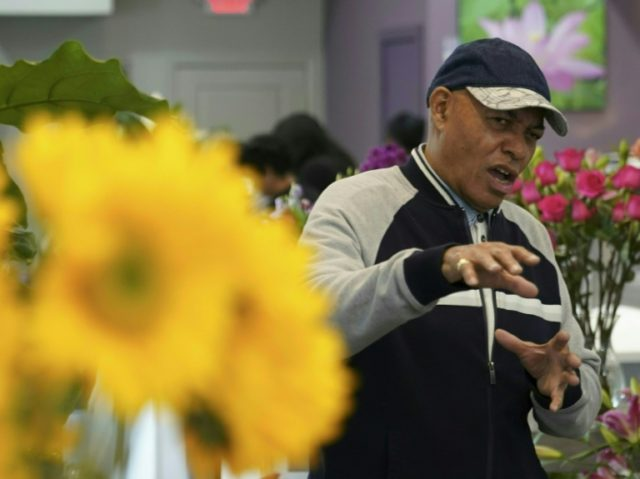Rick Lee went to the family's flower shop in Washington to protect it and his mother from the riots that broke out in the US capital after Martin Luther King was assassinated in 1968