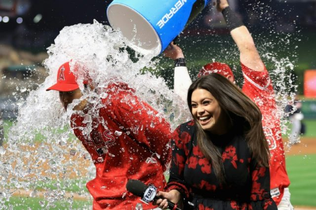 Kole Calhoun dumps water on Shohei Ohtani of the Los Angeles Angels of Anaheim after defeating the Cleveland Indians 13-2
