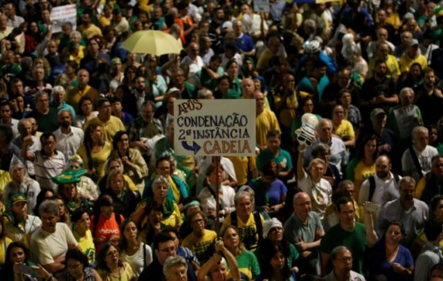 Demonstrators against former Brazilian President Luiz Inacio Lula da Silva hold a rally demanding his imprisonment, in Sao Paulo